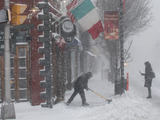 Alex Martinez shovels the entrance to Materas on a