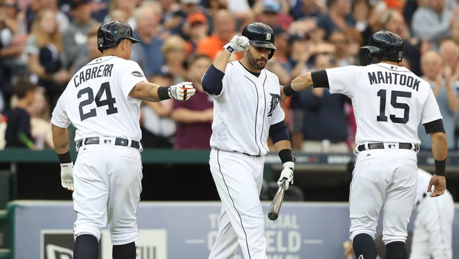 (From left) Tigers first baseman Miguel Cabrera, rightfielder J.D. Martinez and centerfielder Mikie Mahtook celebrate after a Cabrera three-run homer Tuesday at Comerica Park.