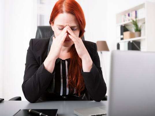 Young businesswoman crying on desk