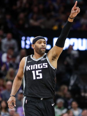 Vince Carter celebrates after a play against the Cleveland Cavaliers.