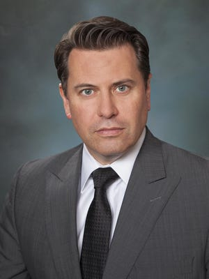 Laurent Badoux, attorney with Greenburg Traurig.