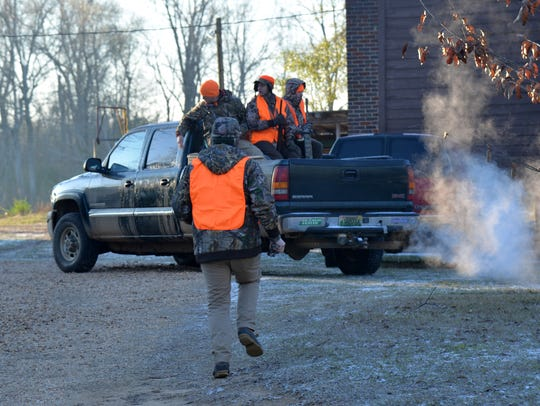 Hunters load up for the ride out to deer stands to
