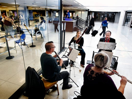 January 31, 2014 – Members of the Memphis Symphony Orchestra perform near the TSA checkpoint in concourse B at the Memphis International Airport Friday afternoon. The symphony is in financial trouble and will look for savings through job and pay cuts.