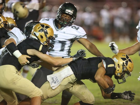 Xavier Prep's Juan Lua, carrying the ball here against Twentynine Palms, was one of six Saints to be named All-CIF.
