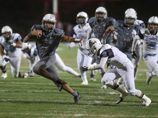Marques Prior of Rancho Mirage runs for a first down
