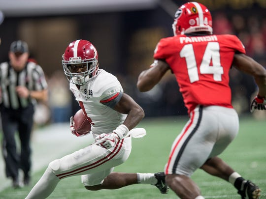 Alabama wide receiver Jerry Jeudy (4) carries against Georgia in second half action of the College Football Playoff National Championship Game in the Mercedes Benz Stadium in Atlanta, Ga., on Monday January 8, 2018. (Mickey Welsh / Montgomery Advertiser)