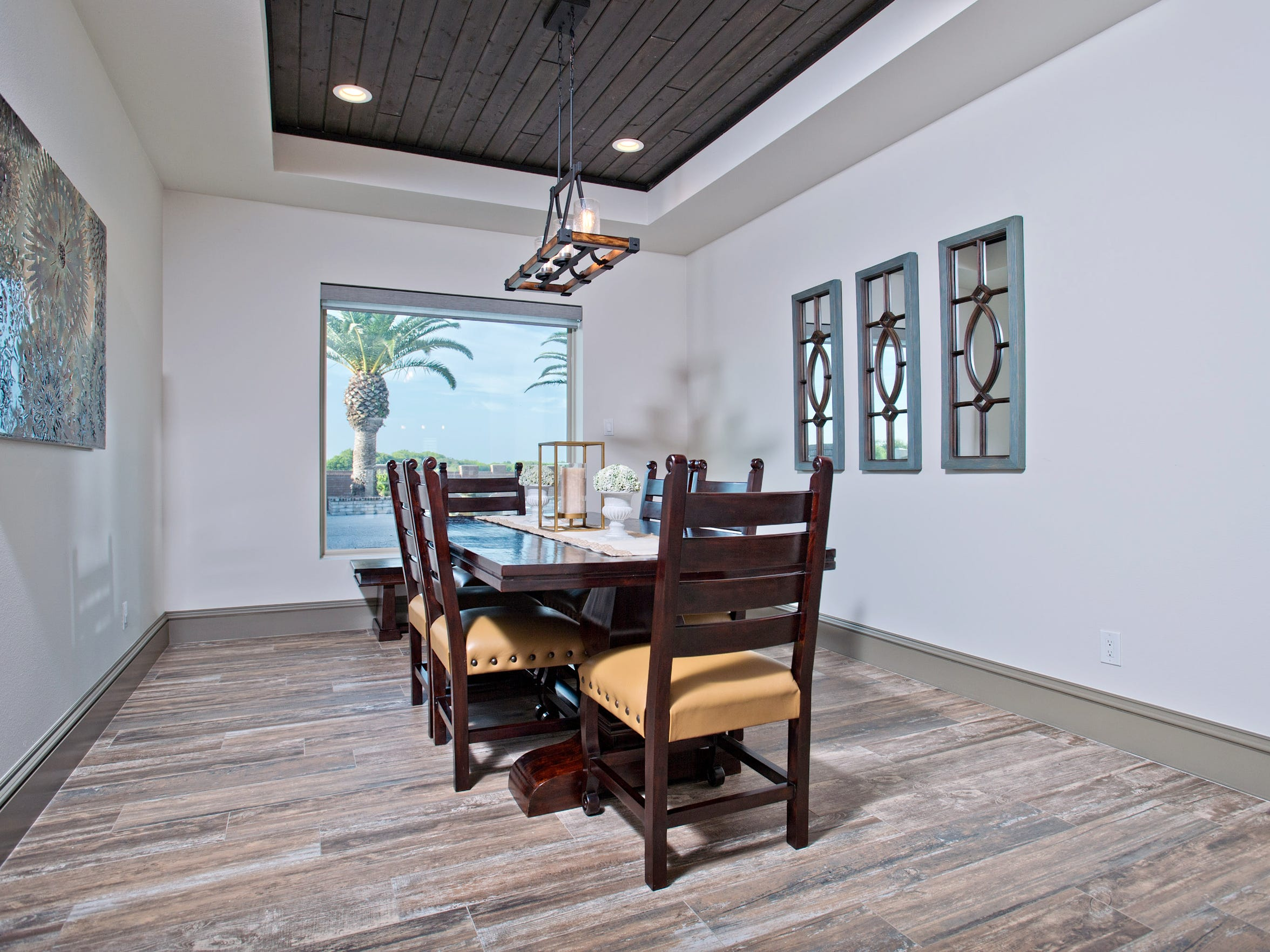 The roomy dining space features a wood recessed ceiling