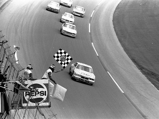 Richard Petty takes the checkered flag at the 1984
