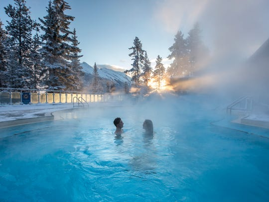 Guests warm up in the Banff Upper Hot Springs, a destination
