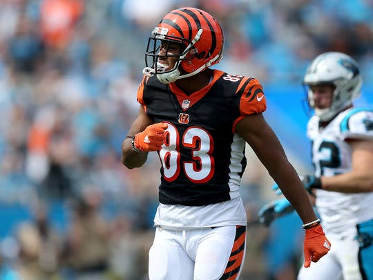 Cincinnati Bengals wide receiver Tyler Boyd (83) pumps his chest after a reception in the first quarter during a Week 3 NFL game between the Cincinnati Bengals and the Carolina Panthers, Sunday, Sept. 23, 2018, at Bank of America Stadium in Charlotte, North Carolina.
