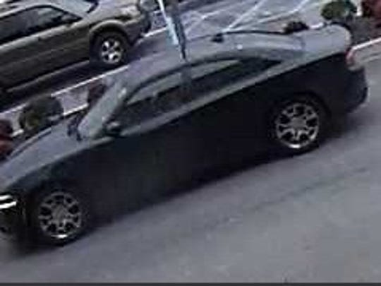 Police said the pictured car was the getaway car in a Christiana Fashion Center armed robbery.