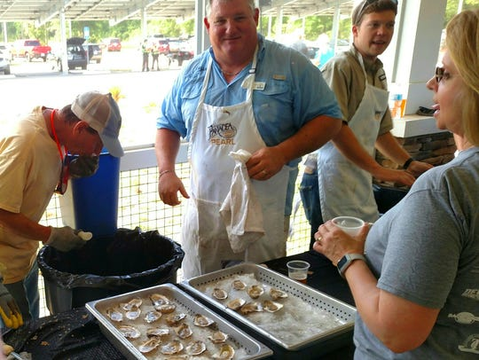 """Finley Cook one of the top oysters """"shuckers."""""""
