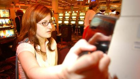 Amy Witherby pulls the handle for a slot machine while gambling at Grand Victoria Casino in Rising Sun.