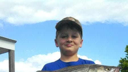 Zane McWhorter with a nice lake Martin stripe bass.