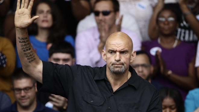 In this Sept. 21, 2018 photo Braddock, Pa., Mayor John Fetterman speaks at a campaign rally for Pennsylvania candidates in Philadelphia. Fetterman, Pennsylvania's newly elected lieutenant governor, says he does not plan to move into the lavish state-owned official residence and hopes to make it available for some type of public use. (AP Photo/Matt Rourke)
