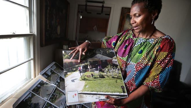 Janice Mondie pulls out photos of what her street used to look like before Memphis Light, Gas and Water bought out many of her neighbors and leveled their homes. Mondie and other residents in her North Memphis neighborhood  are accusing the utility  of strong-armed tactics in pressuring them to sell in order to expand an MLGW service center.