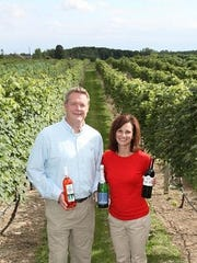 Steve Johnson and Maria Milano of Parallel 44 with some of their award-winning wines.
