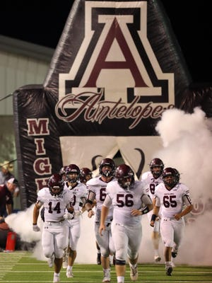 The Abernathy Antelopes enter the field at the start of the second half of a nondistrict game Sept. 4 against Slaton at Tiger Stadium in Slaton.