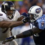Then-Baltimore Ravens tackle Harry Swayne blocks Jevon Kearse in a game in 2000, the second-to-last of Swayne's 15 NFL seasons.