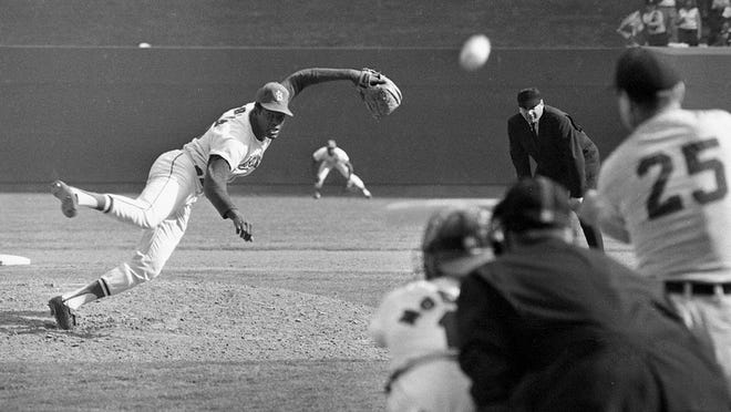 Bob Gibson pitches to Norm Cash during the 1968 World Series.