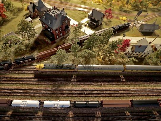 Railroad cars roll through Gordon Lind's model railroad,
