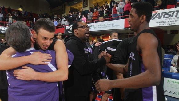 New Rochelle's Khalil Edney, right, is congratulated