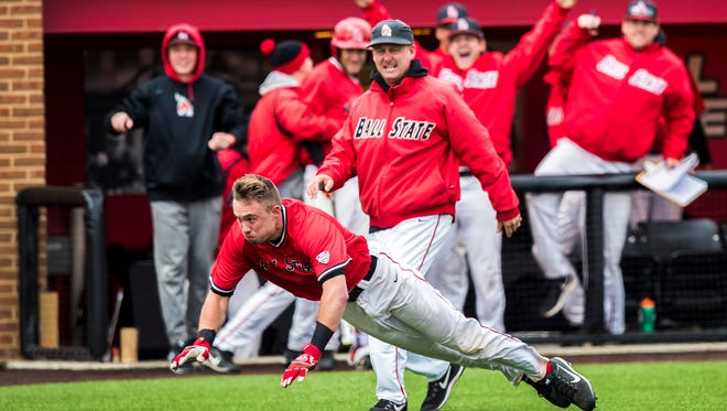 Ball State's Alex Maloney dives for home as his father and coach, Rich Maloney, follows down the third-base line during the 2017 season.