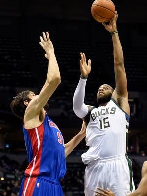 Bucks center Greg Monroe (15) takes a shot against Pistons center Boban Marjanovic (51) in the fourth quarter of the Pistons' 102-89 loss Monday in Milwaukee.