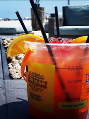 Naked Rum Punch Cruzan bucket cocktail is served with a side order of sea breeze at Bungalow No. 7 in Wildwood Crest.