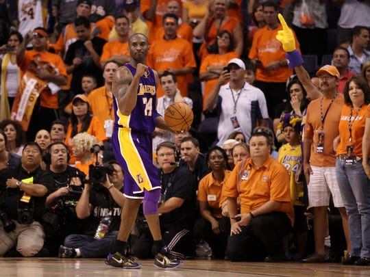 Kobe Bryant of the Los Angeles Lakers reacts in the