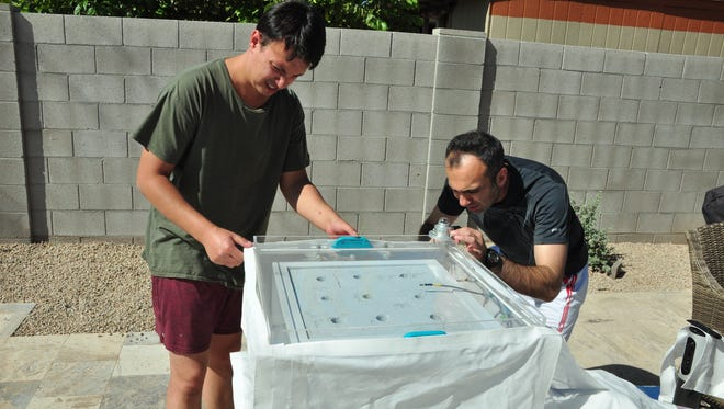 UC Berkeley graduate student Eugene Kapustin and postdoctoral fellow Farhad Fathieh set up the water harvest in Scottsdale in October, 2017.