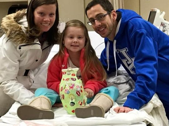 Brittany, Brooklyn and Nick Smith, of Erlanger, at the hospital. Brooklyn was recently diagnosed with DIPG.