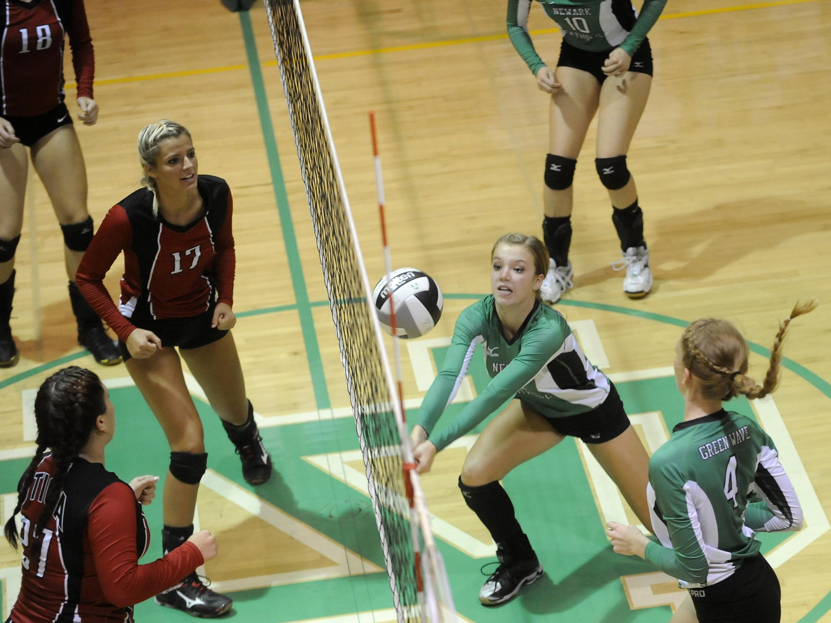 Newark Catholic's Megan Stanton dives for a ball during the Green Wave's victory against Utica in straight sets Thursday.