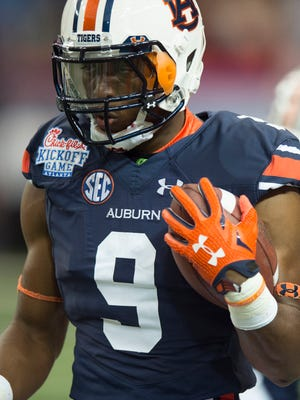 Auburn running back Roc Thomas (9) runs before the NCAA football game between Auburn and Louisville on Saturday, Sept. 5, 2015, in at the Georgia Dome in Atlanta, Ga.