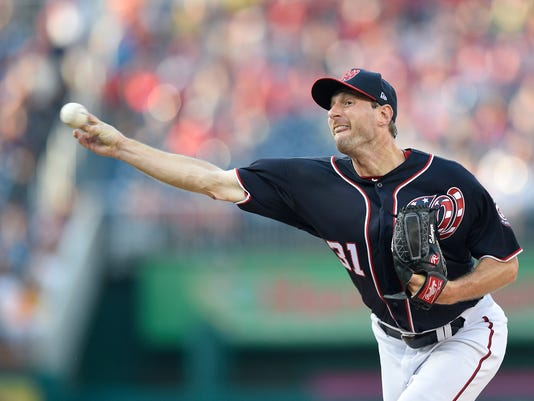 Washington Nationals starting pitcher Max Scherzer delivers during the first inning of a baseball game against the Atlanta Braves, Friday, July 7, 2017, in Washington. (AP Photo/Nick Wass)