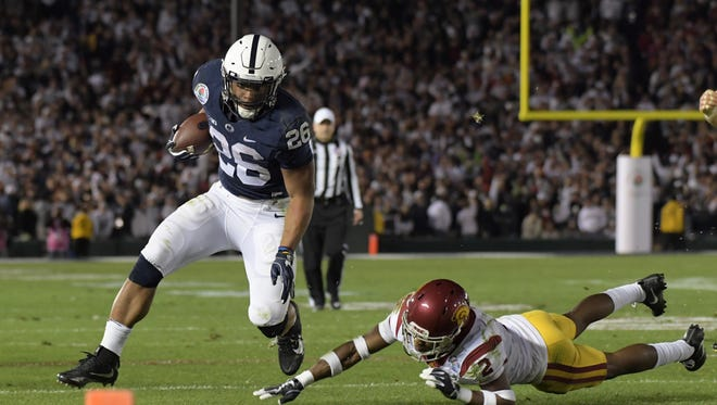 Penn State's Saquon Barkley out runs Southern California defensive back Adoree' Jackson during the 2017 Rose Bowl.