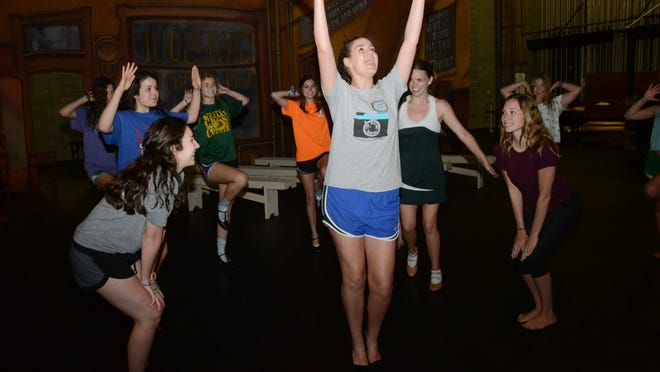 "Erickson (center, gray shirt) portrays Mss Adelaide in the Menard production of Guys and Dolls. Erickson and other cast members rehearse the song, ""A Bushel and A Peck"" Thursday at the Coughlin-Saunders Performing Arts Center in downtown Alexandria."