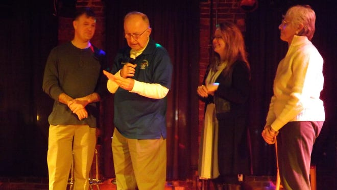 Phil Earlywine, Keith Kendall, Misty Hollis and Janice Edelman accept a check for the Kiwanis Club of Richmond from the InCONCERT series.