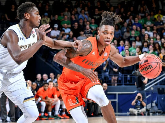 Miami Hurricanes guard Lonnie Walker IV dribbles against Notre Dame Fighting Irish guard T.J. Gibbs in the first half at the Purcell Pavilion in South Bend, Ind.