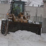 Snow plows tackle another snowfall