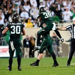 MSU running back Madre London breaks through a big hole against Oregon defense in the first half Saturday at Spartan Stadium.