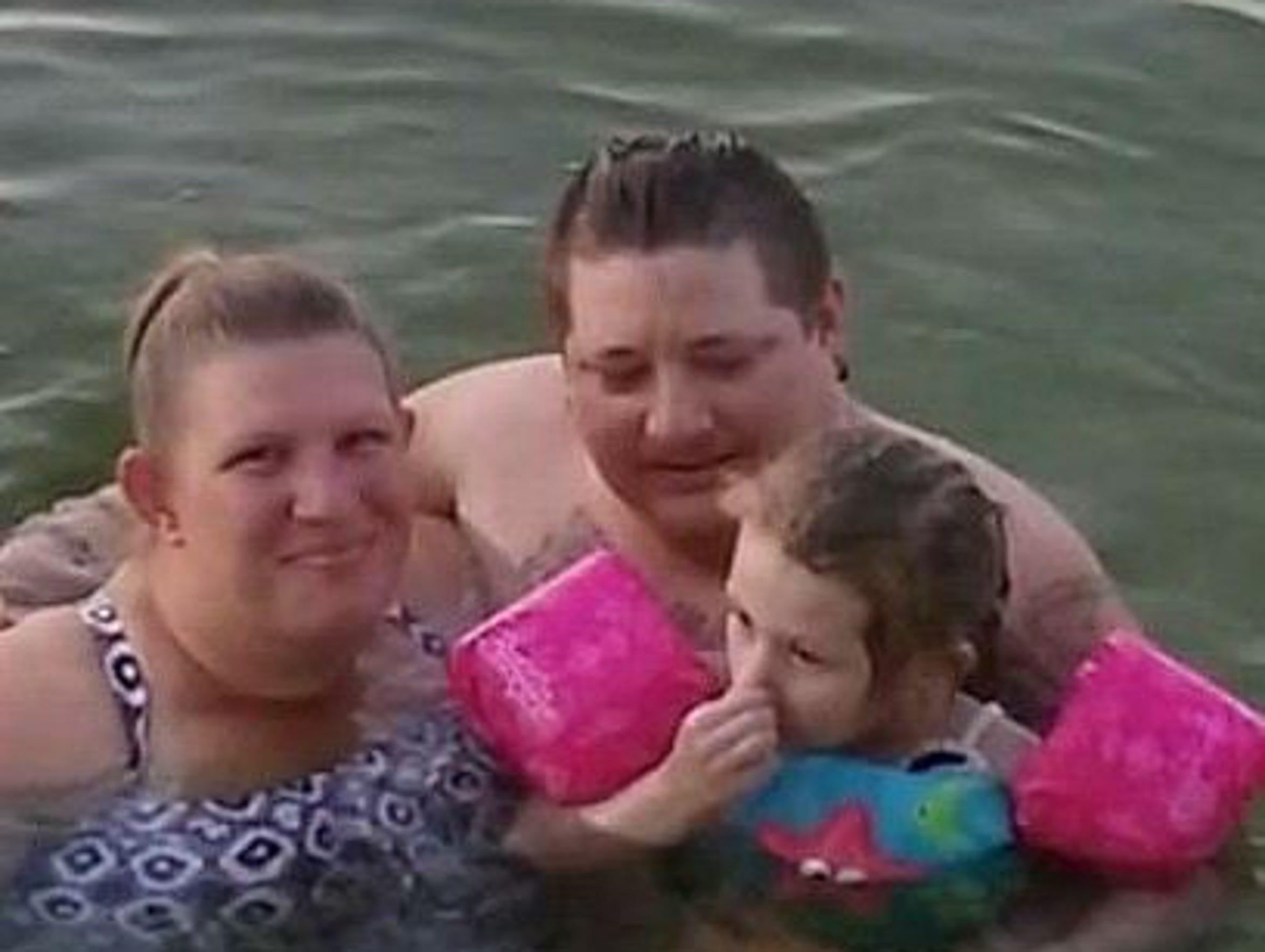 Ginger Wright, from left, Josh and Dakota Wright swimming