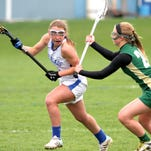 Mia Strollo of Horseheads looks to move around Vestal defender Amanda Fedor during Wednesday's Section 4 game.