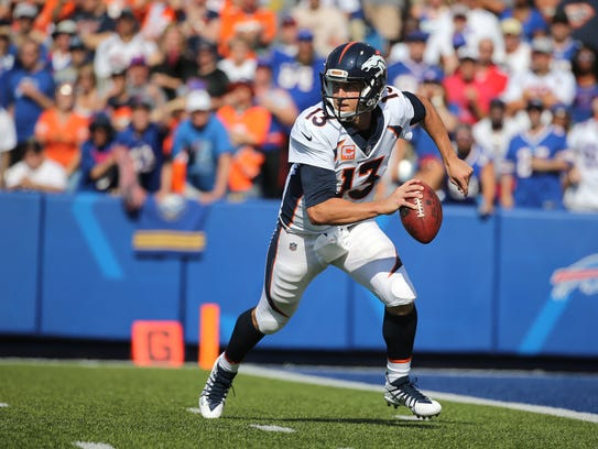 Broncos quarterback  Trevor Siemian is pressured out