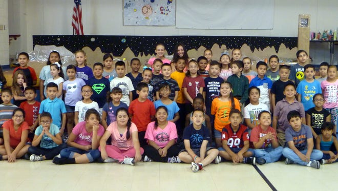 Students in second and fifth grades pose in front of the Mars colony they created during the K-5 Plus Summer Program at Bataan Elementary School. The program was project-based, with the emphasis being on the students' journey to Mars. Standing in the back row are teacher, Kim Perea's grandkids, who assisted with various projects throughout the summer program.