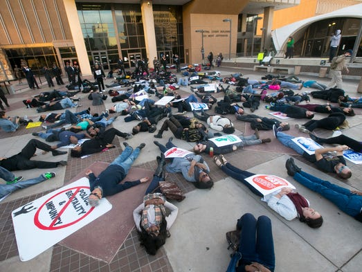Dozens lay down in front of Maricopa County Superior