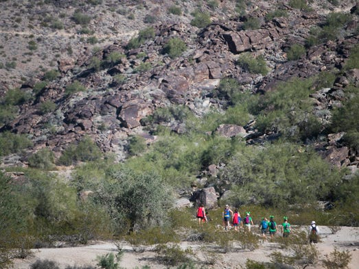 Hikers make their way up Holbert trail during the Seven