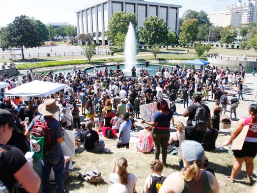 People gather in Marshall Park in Charlotte to protest