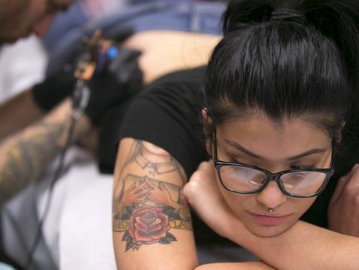 "Karina Fliss of San Tan Valley gets a number ""13"" tattoo"
