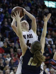 De Pere's Olivia DeCleene takes it to the basket over